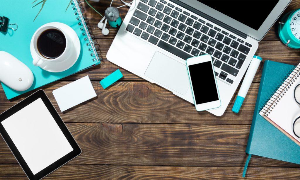 Tablet, laptop, desk.